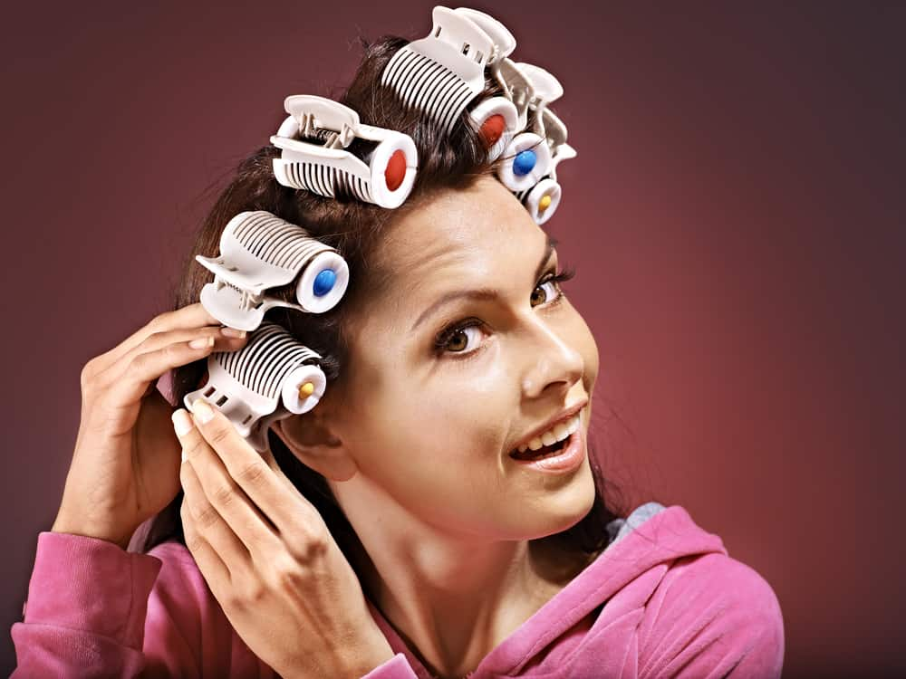 curl your hair using hot rollers